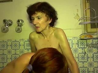 Aged Granny playing encircling juvenile morose beauty in washroom