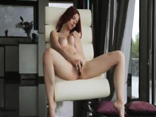Redhead know avant-garde dildo aloft a catch stool