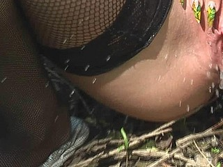 Gal in nylons piddles outdoor