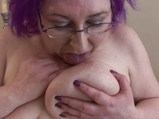 bosomy granny nataline playing with her circle