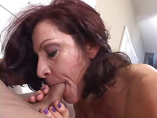 Hot mature brown masterfully sucks cock while smoking a cigarette