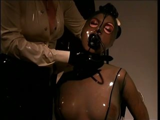 Slave Girl Wrapped In Skintight Latex