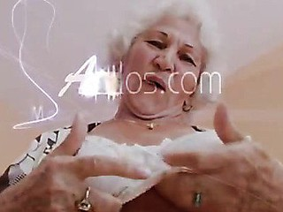 Large titted grandma plays with the brush boobs and the brush old cunt