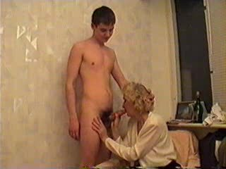 Full-grown Lady Together with a Young Guy Take Some Ceremonial r�le of