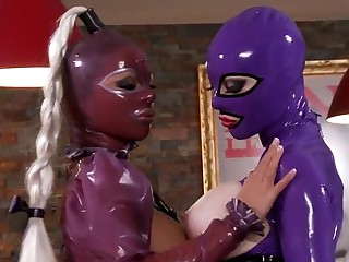 Latex Lucy and Black Angelica licking boobs