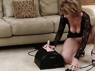 Gorgeous cougar thoroughly enjoys her first sybian ride